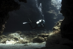 Diver in Swim Through in Grand Cayman