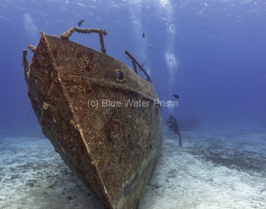 Diver alongside the C53 wreck in Cozumel